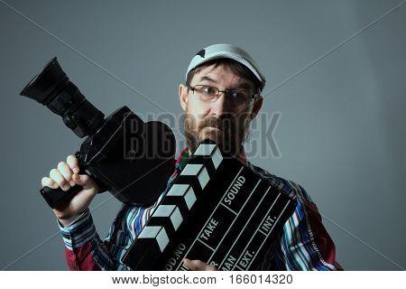 Man Retro Movie Camera And Clapper