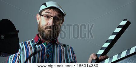 Man Retro Movie Camera And Clapperboard