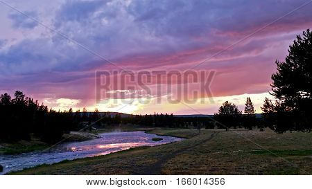 Sunset over steaming Firehole river. Midway Geyser Basin. Yellowstone National Park. Jackson Hole. Wyoming. United States.