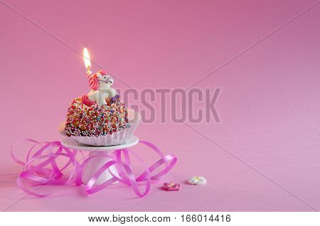 birthday cake - mini gugelhupf with sugar sprinkles and birthday candles