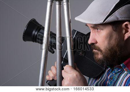 Bearded Man Movie Camera Tripod