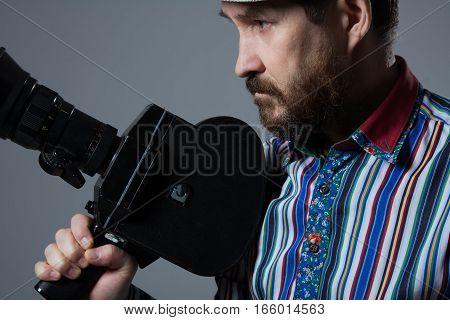 Bearded Man Movie Camera Thoughtfully
