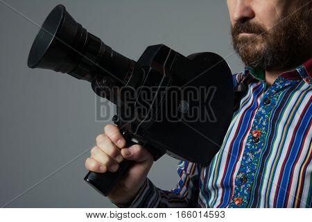 Bearded Man Movie Camera Thoughtfully Looks