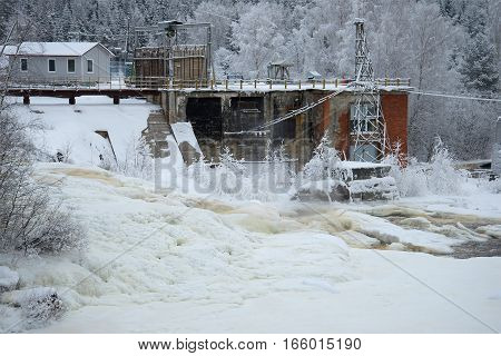 Hydroelectric power station (GES-22 1936 of construction) on the river Yanisyoki in the cloudy January afternoon. The village of Harlu Karelia. Russia