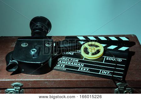 Old Movie Camera Clapper And Reel With A Film