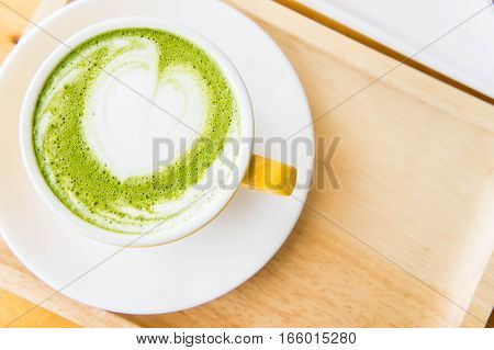 green tea hot milk cup in coffee shop