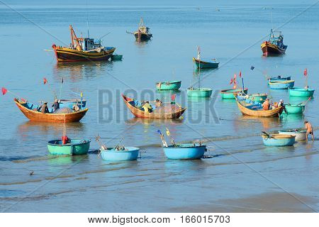 MUY NE, VIETNAM - DECEMBER 25, 2015: Morning in the Fish harbor. A view of fishing boats after night fishing