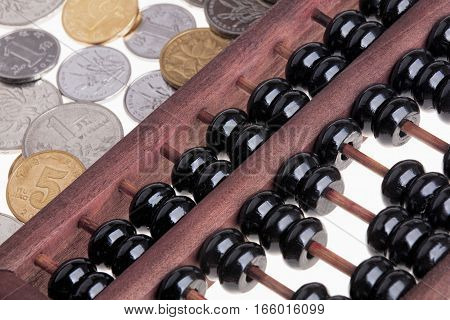 Close up of an old wooden Chinese Abacus and Chinese coins