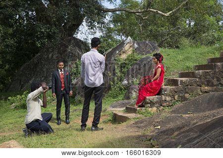 ANURADHAPURA, SRI LANKA - MARCH 13, 2015: Wedding photography on the ruins Wessagirie