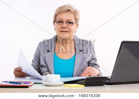 Elderly Business Woman Working With Documents At Desk In Office, Business Concept