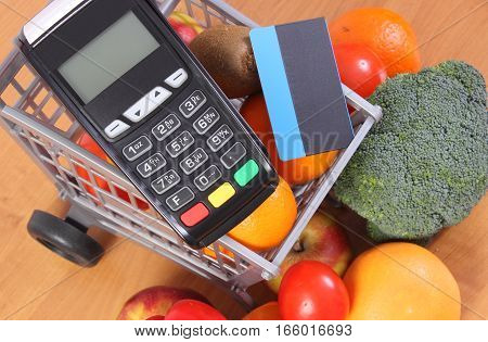 Payment Terminal And Credit Card With Fruits And Vegetables, Cashless Paying For Shopping, Finance C