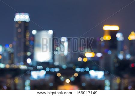 Night lights blurred bokeh office building abstract background