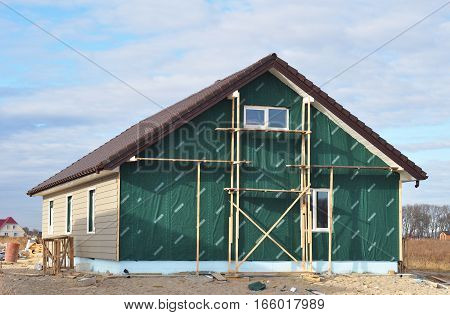 KIEV UKRAINE - JANUARY 23 2017: Building New House with Plastic Siding and Insulation Membrane on House Wall.