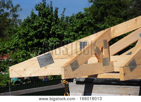 Close up on Corner Roofing Construction. Wooden Roof Frame House Construction