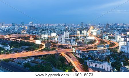 Aerial view Bangkok city higway over residence area skyline at twilight Thailand