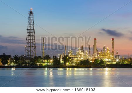 Oil refinery water front sunrise tone industrial background