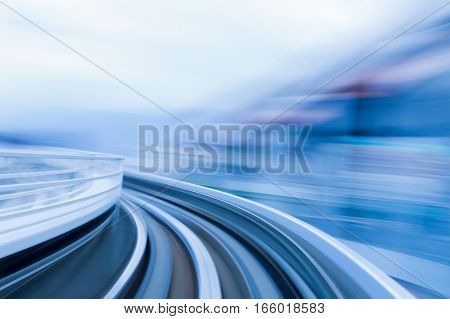 Motion blurred moving train in tunnel abstract background