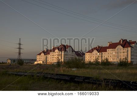 City multi-storeyed building in the sunset light