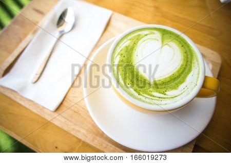 green tea milk hot cup in coffee shop