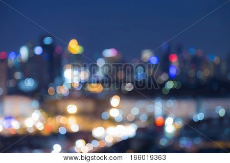 Night city blurred bokeh lights abstract background