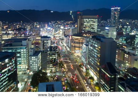 Aeril view blurred lights Kobe city downtown with mountain backgorund at night