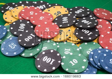 background laid out chips for poker, different colors and with different face value