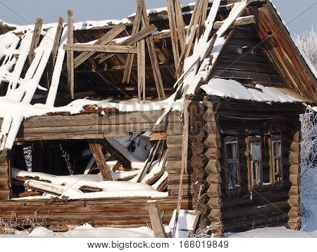 the destroyed house on the suburb of the village left by the owners