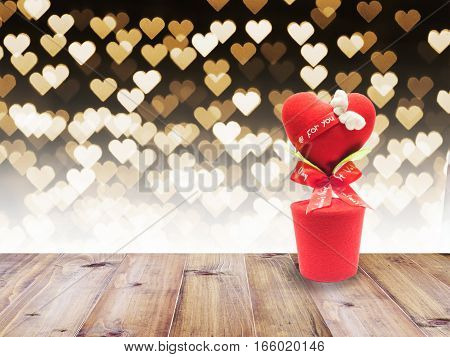 Love heart flowerpot on wooden table over heart bokeh abstract for Valentine's day background