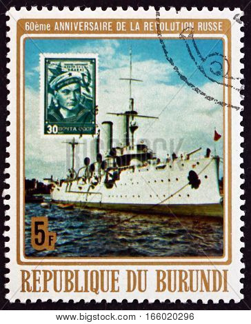 BURUNDI - CIRCA 1977: a stamp printed in Burundi shows Cruiser Aurora 60th Anniversary of Russian October Revolution circa 1977