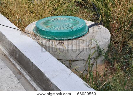 Manhole Water Borehole under Construction. Water supply system. Hydraulic accumulator water pump and other equipment