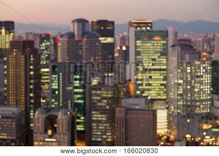 Office building blurred lights night view Osaka Japan