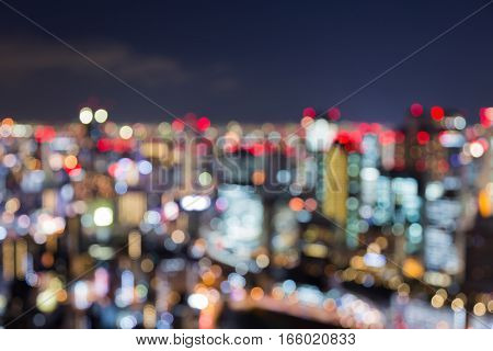 Twilight skyline blurred bokeh lights Osaka business downtown abstract background