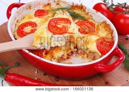 Casserole with minced meat fresh tomatoes and cheese