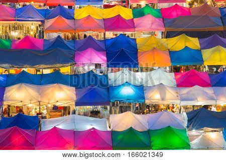 Colourful city night market top view, aerial view