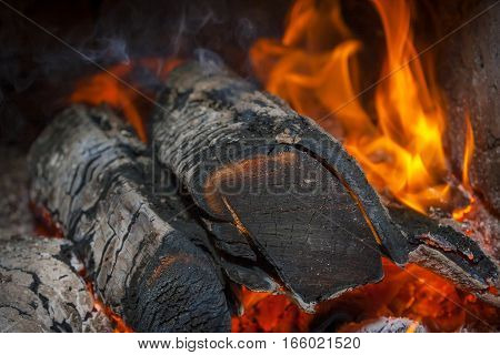 Flames burning wood in your home fireplace