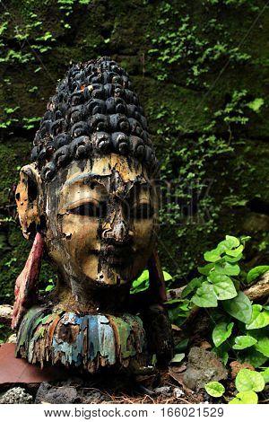 Art junk in Bali art workshop neglected. A broken wooden statue still have an art although broken.