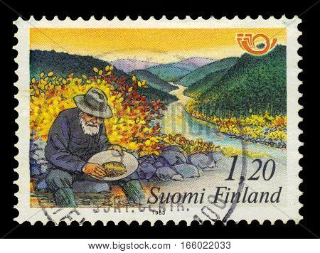 FINLAND - CIRCA 1983: a stamp printed in Finland shows old gold digger in North Finland, circa 1983