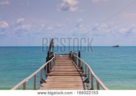 Wooden jetty leading to the seacoast natural coastline landscape