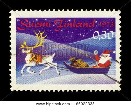 FINLAND - CIRCA 1973: a stamp printed in Finland shows Santa Claus with sledge and gifts, series Christmas, circa 1973