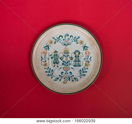 Empty plate European style on red background