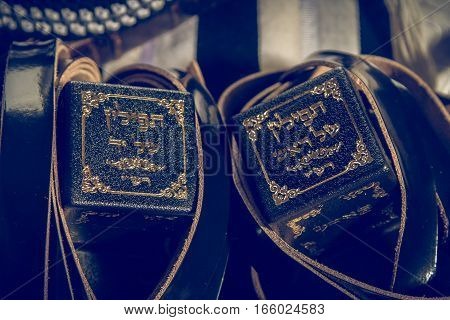 Jewish ritual objects prayer vestments Tefillin with a hebrew inscription - the arm tefillin and the head tefillin. Toned image