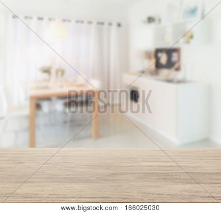 Wooden Table Top With Blur Of Wooden Dining Table Next To Pantry In Modern Kitchen