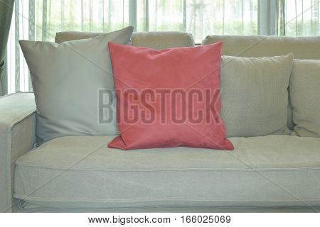 Red Velvet Pillow With Gray Color Couch And Pillows In Living Room