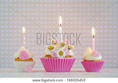 homemade birthday cake with daisy and hearts