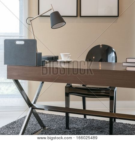 Wooden Table And Books In Modern Working Room Interior