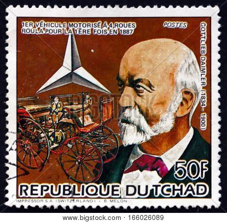 CHAD - CIRCA 1985: a stamp printed in Chad shows Gottlieb Daimler German Pioneer of Automobile Development and 1887 Motor Carriage circa 1985