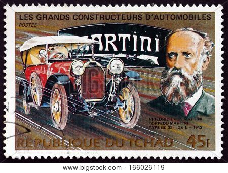 CHAD - CIRCA 1983: a stamp printed in Chad shows Friedrich Martini Swiss Automobile Manufacturer and Automobile Torpedo Martini Type GC 32-2 6L circa 1983