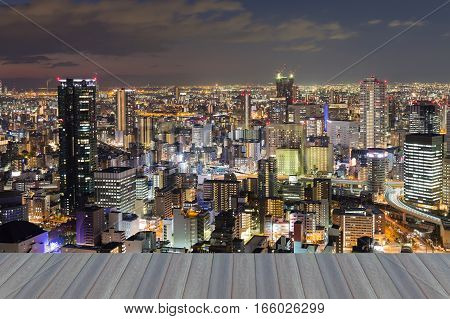 Opening wooden floor Osaka city night lights cityscape downtown night view Japan