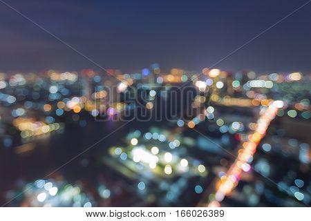 Blurred lights city of Bangkok at night aerial view