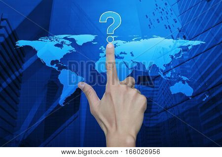 Hand pressing question mark sign icon over map and city tower Customer support concept Elements of this image furnished by NASA